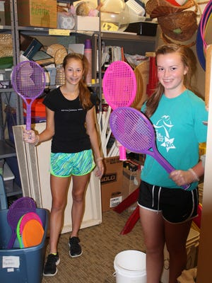 St. Ignatius students Nicole Raymond and Paige Lewis clean the activities closet at Bayley Place.