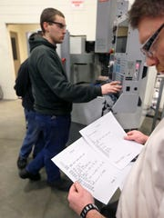 Travis Reglin, left, and instructor Marty Kroell in a technical class at Lansing college. Labor pools for industrial jobs have shrunk.