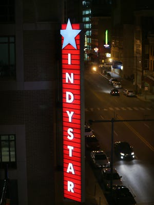 A lighting test for the sign at the new Indianapolis Star building on Thursday, September 11, 2014 at Circle Centre Mall shows off a range of colors that can be changed with a remote control.