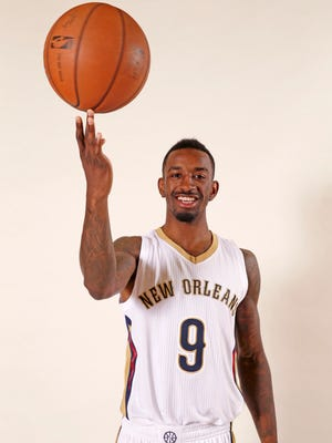 New Orleans Pelicans guard Russ Smith poses at the Pelicans NBA basketball media day in Metairie, La., Monday, Sept. 29, 2014.
