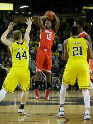 Ohio State forward Sam Thompson shoots over Michigan forward Max Bielfeldt (44) during the second half of the Buckeyes 64-57 road loss on Sunday.