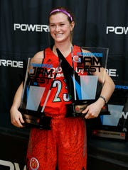 Mar 31, 2014; Chicago, IL, USA; McDonalds High School All American guard Alexa Middleton (23) holds two trophies after winning the girls skills competition and three point shooting contest during the Powerade Jamfest at the Gerald Ratner Center . Mandatory Credit: Brian Spurlock-McDonalds