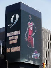 A large electronic billboard in Cleveland welcomes back NBA basketball star LeBron James on Friday after he announced he would return to the Cleveland Cavaliers.