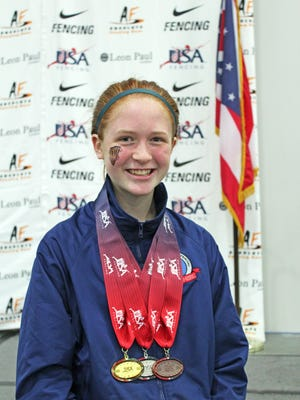 Salem's Megan Eno came away with three medals from fencing competitions in Columbus, Ohio. The already-accomplished fencer will be a freshman at Sprague this year.