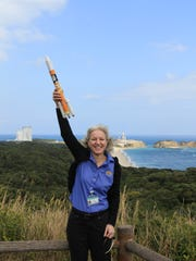 Gail Skofronik-Jackson, who grew up in Tallahassee, cheers at Tanagashima Island in Japan in February 2014 just before launch of the satellite that allows NASA's Global Precipitation Measurement program to more accurately predict precipitation around the world.