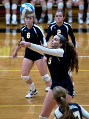 DeWitt's Grace George hits the ball during the second