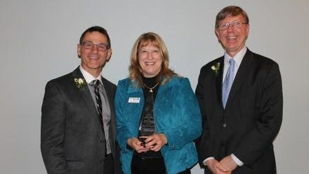 Recipient of the 2015 Volunteer of the Year was recognized during the Fond du Lac Association of Commerce Annual Meeting.  From left are Tom Schneider, AC Board Chair; Marcia Snyder of Hometown Bank; Rick Parks, AC Past Chair.