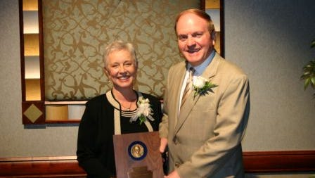Michael Kaczenski, chairman of the Pennsylvania Credit Union Association, presents the PCUA's 2010 William Pratt Lifetime Achievement Award for Credit Union Professional of the Year to  Peggy Bosma-Lamascus, who retired as Patriot Federal Credit Union CEO on Jan. 1, 2016.