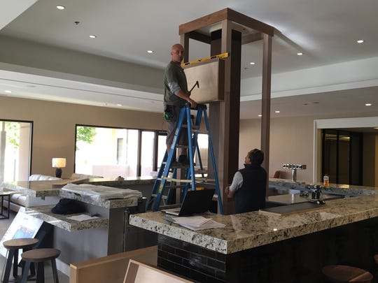 Workers complete the installation of the new bar at the Double Tree by Hilton Golf Resort Palm Springs, which was the former Desert Princess resort in Palm Springs.