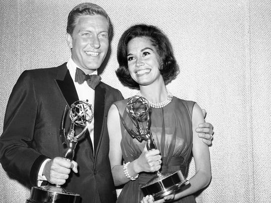 "Dick Van Dyke, left, and Mary Tyler Moore, co-stars of ""The Dick Van Dyke Show"" backstage at the Palladium with their Emmys for best actor and actress in a series at the Television Academy's 16th annual awards show on May 25, 1964."