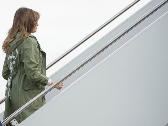 First lady Melania Trump boards a plane at Andrews