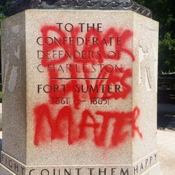 "This June 21, 2015, photo shows a statue memorializing the Confederacy spray-painted with the message ""Black Lives Matter"" in Charleston, S.C."