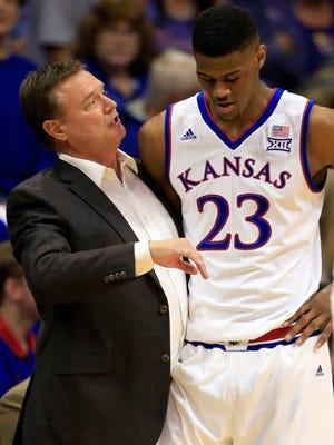 Kansas head coach Bill Self (left) talks with Kansas forward Billy Preston in a preseason game. Self held Preston out of the season opener against Kentucky.