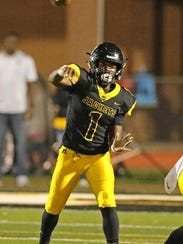 Starkville quarterback Malik Brown throws a pass during the first half Friday against Clinton.