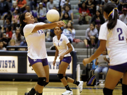 Kirtland Central's Jordan Begay keeps the ball in play during a match against Monument Valley, Ariz., Saturday at the Jerry A. Conner Fieldhouse in Farmington.