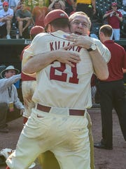Arkansas Athletic Director Jeff Long celebrates with pitcher Trey Killian (21) after the Razorbacks defeated Missouri State, 3-2, in the Super Regional at Fayetteville.