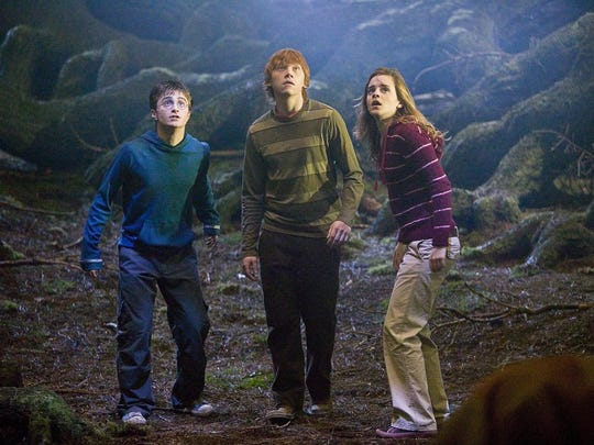 """Daniel Radcliffe, Rupert Grint, and Emma Watson in a scene from """"Harry Potter and the Order of the Phoenix."""""""