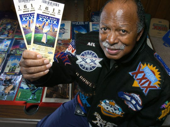 Gregory Eaton shows his tickets for the 2005 Super