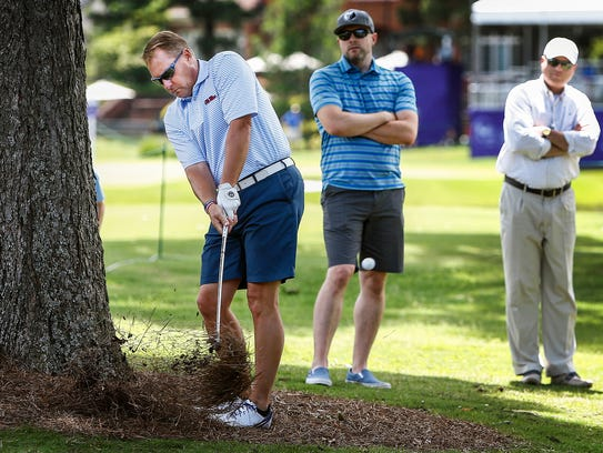 Ole Miss football coach Hugh Freeze hits out of the