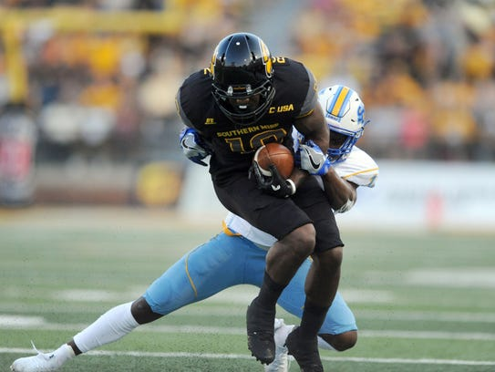 Southern Miss wide receiver Korey Robertson catches