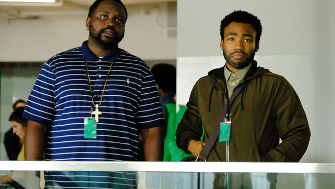 """In Season 2 of FX's """"Atlanta,"""" Ern (Donald Glover, right) attempts to set rapper Paper Boi's (Brian Tyree Henry) career in motion after he scores a breakthrough radio hit."""