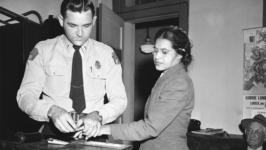 In this Feb. 22, 1956, photo, Rosa Parks is fingerprinted by police Lt. D.H. Lackey in Montgomery, Alabama. She was among some 100 people charged with violating segregation laws.