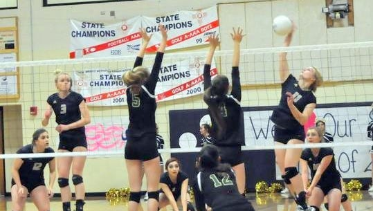 A Ruidoso player slams a shot in a volleyball matchup in 2016.