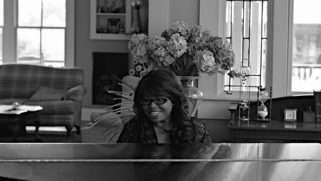 """Octavia Jackson Williams of Pineville plays piano and sings """"Father's Day,"""" a song she wrote in 2012, on a video produced locally and released online June 14. The video is available on her Facebook page, at www.simplyoctavia.com and on YouTube."""