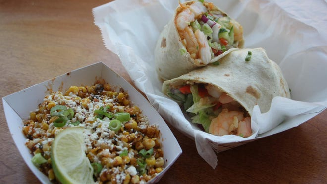 A shrimp burrito with vegetable fried rice and a side of Korean esquites, a blend of corn,cotija cheese, lime juice and kimchi, at MOGO Korean Fusion Tacos in Asbury Park. The restaurant will host its monthly Beer Dinner tomorrow night.
