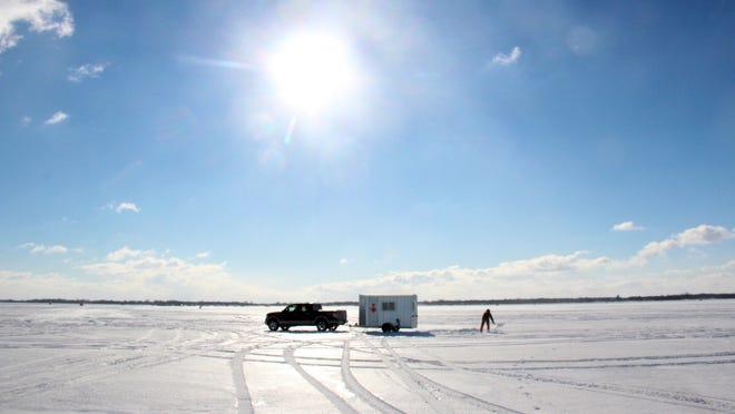 Brent Martin of Berlin shoveled snow from the ice on Lake Poygan as he set his sturgeon spearing shanty for the 2016 Winnebago sturgeon season.