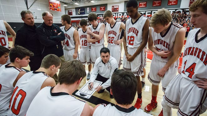 Pewaukee coach Mike Basile (center) won 78% of his games during his six seasons as head coach.