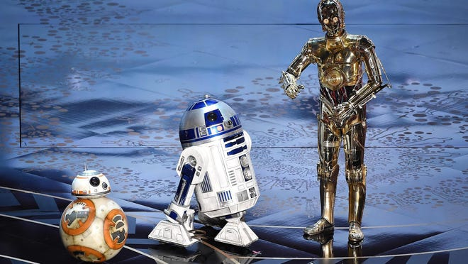 """BB-8 (from left), R2-D2, and C-3PO from the """"Star Wars"""" franchise."""