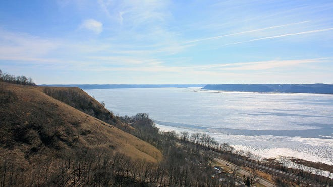 A trail at Rush Creek State Natural Area leads to an open bluff top and sweeping views of the Mississippi River.