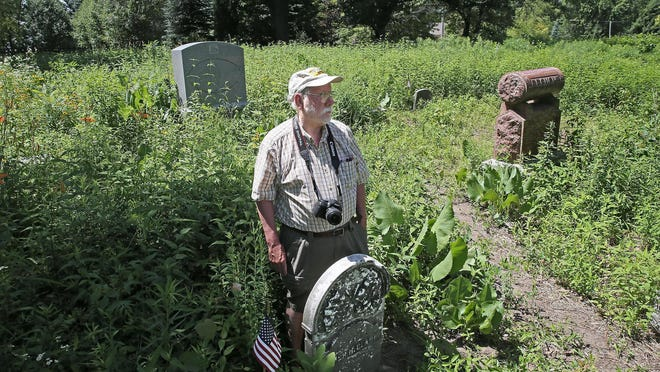 Dave Daley, a member of the Sons Of Union Veterans, stands next to the grave of Homer Clark, a lieutenant in the 16th U.S. Infantry who died of wounds suffered at the Battle of Chickamauga. The Sons of Union Veterans of the Civil War in Wind Lake are upset with the condition of Luther Parker Cemetery in Muskego. City officials say the site preserves its natural history.