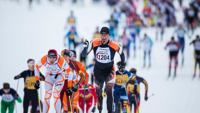 Men's and women's elite classic-style skiers start the 40th American Birkebeiner cross-country ski race from Cable to Hayward in 2013.