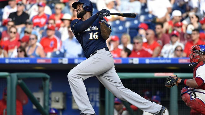 Domingo Santana hits a solo home run during the Brewers' 6-3 win over the Phillies on June 4.