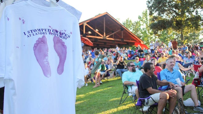 A grape stomp t-shirt and the crowd at last year's Red Grape Stomp Fest at Landry Vineyard. The event is Saturday from 4-7:30 p.m.