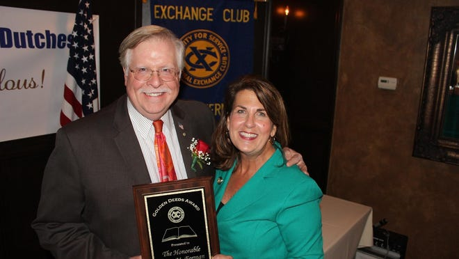 """Judge Peter M. Forman accepts the """"Book of Golden Deeds Award"""" from Exchange Club of Southern Dutchess President Denise Doring VanBuren in recognition of its decades of service to others."""
