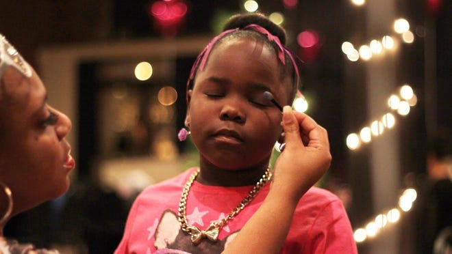Toward the end of the evening, volunteers will help the girls put on makeup for a fashion show.