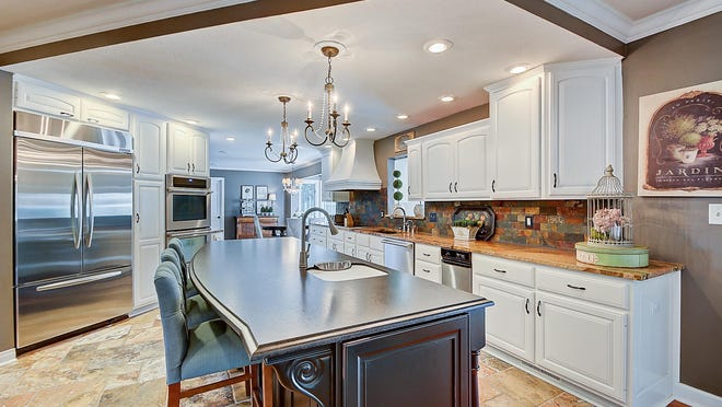 Chandeliers add a touch of class to the kitchen.