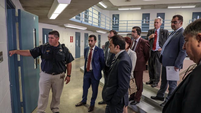 Caddo Sheriff's Sgt. Robert Montoya conducts a tour of CCC for Armenian judges participating in the Open World, Rule of Law Program.