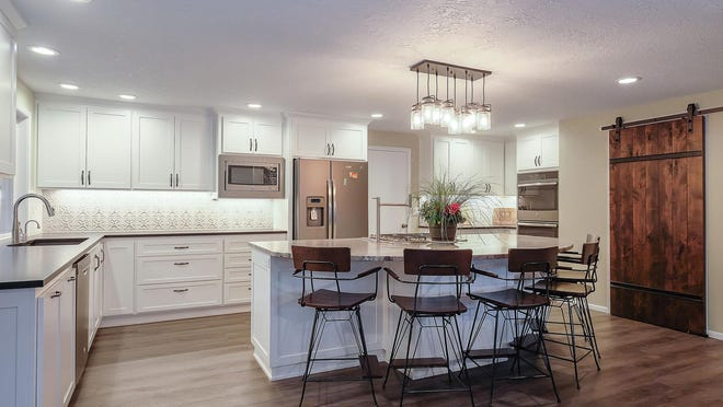 In this recent Keizer kitchen remodel, Dale's Remodeling blends classic style with rustic trends for a timeless look. A Kichler Braelyn chandelier hangs over the island, and hidden electrical outlets give countertops a clean and clutter-free look.