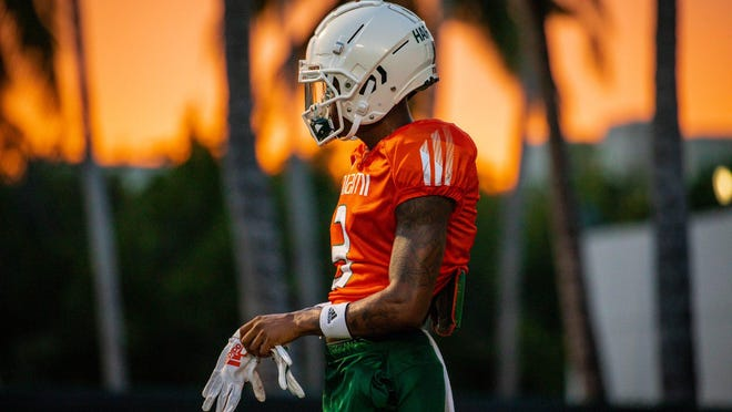 Hurricanes receiver Mike Harley wants to play football and believes it's safer to be on campus than in the community.