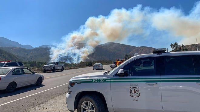 The Brook Fire burns near Cajon Boulevard and Keenbrook Road on Wednesday, July 29, 2020.