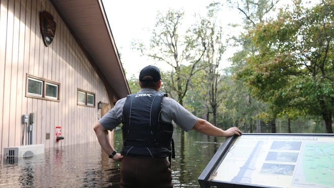 A National Parks Service ranger surveys the flooding at Moores Creek National Battlefield in Currie after Hurricane Florence in 2018.