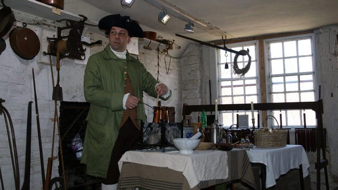 Robert Lecce makes chocolate at the Leffingwell House Museum.
