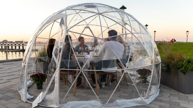 Getting creative for outdoor dining is Woods Hill Pier 4, on Boston's waterfront Seaport district. The restaurant that opened last year has added translucent heated igloos for patio dining for fall and winter.
