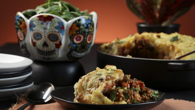 This twist on a shepherd's pie features chiles and black beans for an earthy flavor this Halloween.
