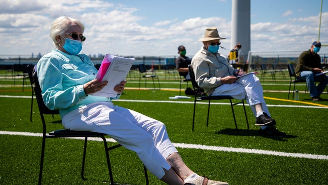 Hull resident of 20-years Jean Kenney reviews the articles that will be voted on before the Hull Annual Town Meeting begins on Saturday, June 13.