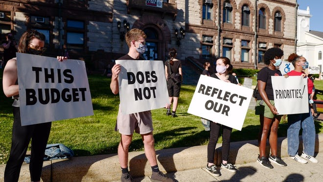 A large crowd gathered Monday, June 8, in front of Cambridge City Hall, calling on officials to defund the Cambridge Police Department.
